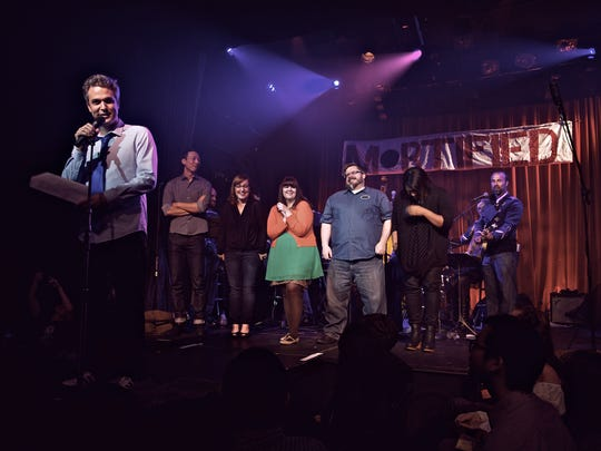 "Dave Nadelberg (foreground) is the founder of the ""Mortified"" storytelling events. He's shown here a Los Angeles event."