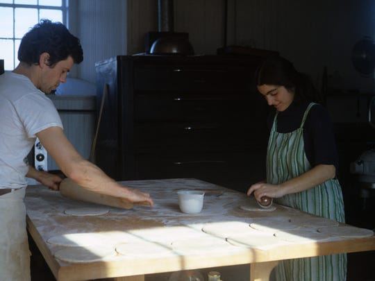 Chuck Conway (left) and Carla Kevorkian (right) roll dough for pitas at O Bread Bakery in 1979.