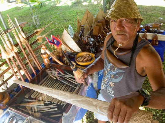 In this file photo, Albert Naburn showcases his work at a fisherman's festival.