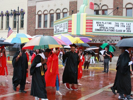 Marshall High School graduates, Class of 2016, marched in the rain during the first ever MHS Graduation Parade through downtown Albion Saturday afternoon