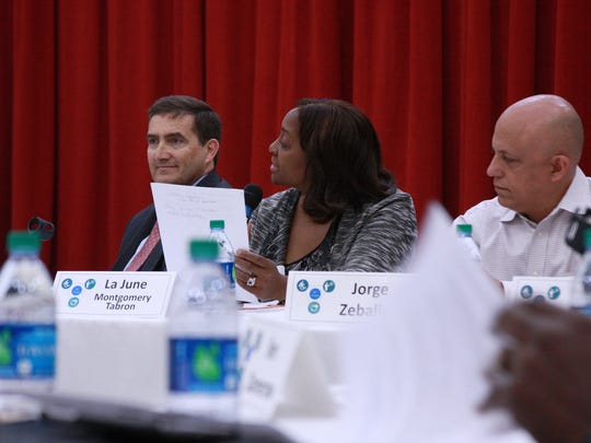 W.K. Kellogg Foundation President and CEO La June Mongomery Tabron, seated next to Kellogg Co. Chairman John Bryant and Kellogg Community College's Jorge Zeballos, asks a question during Wednesday's BC Vision Steering Committee meeting.