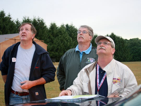 Pilots Pat Rolfe, Michael Moore and Dale Wilson watch
