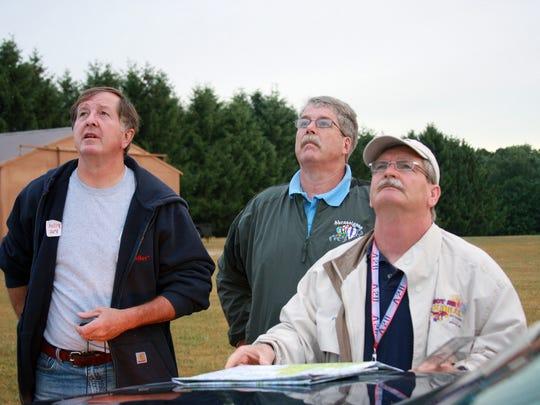 Pilots Pat Rolfe, Michael Moore and Dale Wilson watch