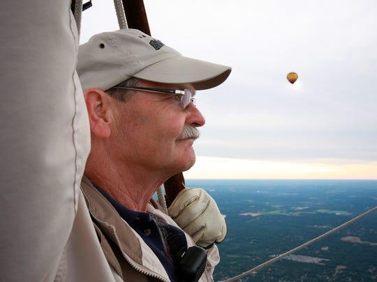 Dale Wilson, pilot of Seventh Heaven, flies over Battle