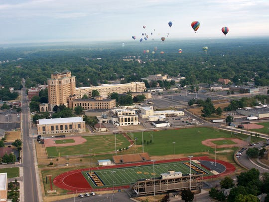 Hot air balloons fly over Battle Creek Central High