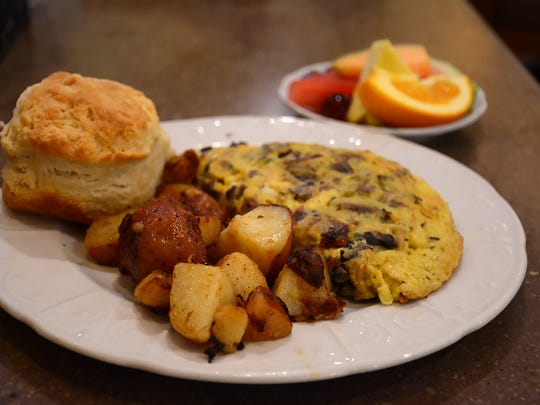 A farmer's omelet with  homemade biscuit, home fries and fruit. The Trail Cafe and Grill on US 41 North serves breakfast and lunch, including homemade baked goods. Lance Shearer/Special to the Daily News