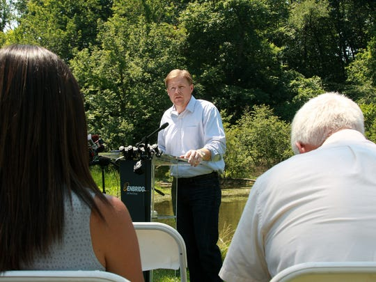 Vice President of U.S. Operations at Enbridge, Brad Shamla, spoke at the press conference Wednesday afternoon at Historic Bridge Park about the settlement between Enbridge and the U.S. Department of Jusitce and the U.S. EPA