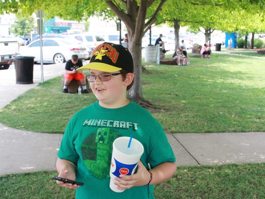 Jaydon Reinke, 11, plays Pokemon Go at Friendship Park