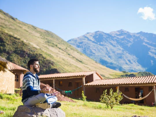 John Hazim is currently teaching yoga in Peru.