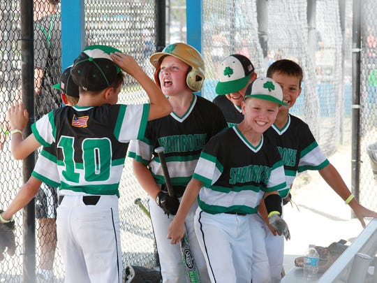 The Shamrocks get pumped up after scoring a run in