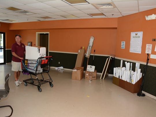 Pat Kuhn moving items out of the game room. The city's Parks & Rec. Dept. is moving its indoor Mackle Park programs to space at the Family Church on Winterberry Drive.