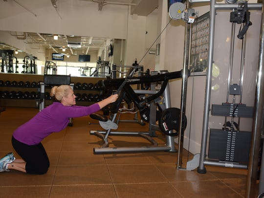Member Patricia Burdette works out. Xcel Fitness Spa in the Shops of Marco offers complete workout options and now Sunday hours.
