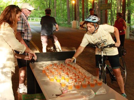 Karen Prater gets a beer sample during Tour de Zoo Thursday evening at Binder Park Zoo.