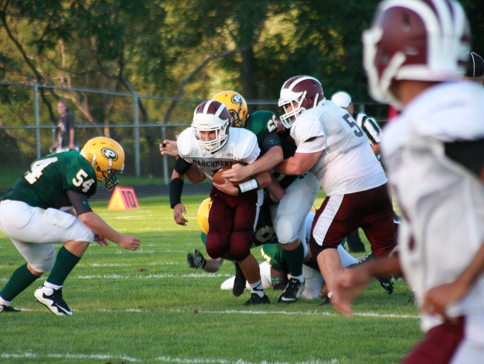 Garrett Stutz of Parchment gets tackled Thursday night against Pennfield.