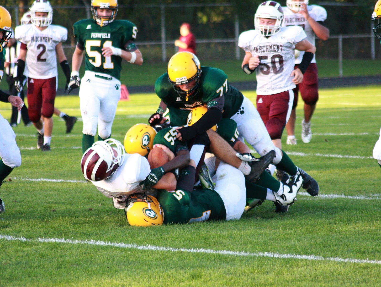 Garrett Stutz of Parchment gets tackled Thursday night against Pennfield