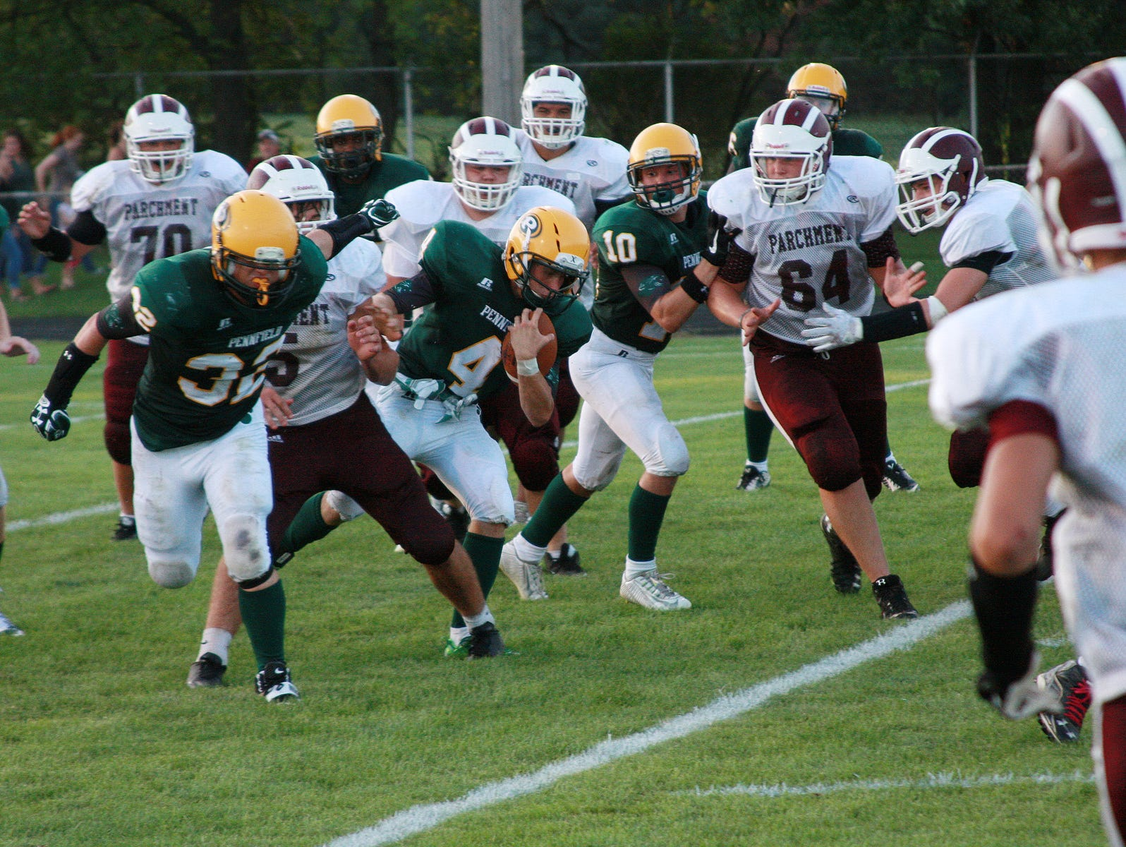 Junior Anton Calamita (4) scores a two-point conversion for Pennfield Thursday evening