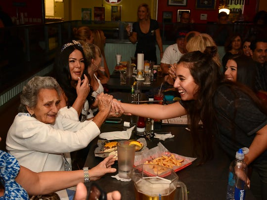 Gianna Minichiello is congratulated by great-grandmother Nancy Minichiello after singing. The 15-year-old sang for an enthusiastic group of family and friends at Weekend Willie's.