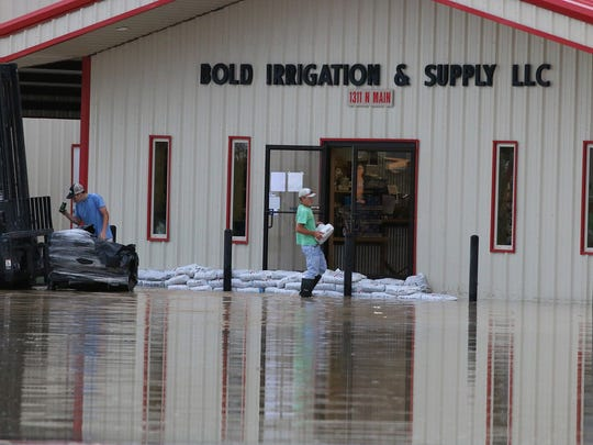 Sandbags are used to keep water out of a local business.