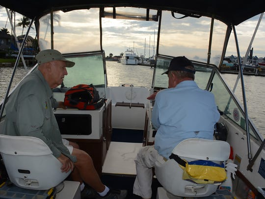 Dawn Patrol Capt. Bill Walsh, right, heads out in the morning with guest Gary Bandelean. Backwater fishing is a great way to get out into nature's beauty, and maybe bring home dinner.