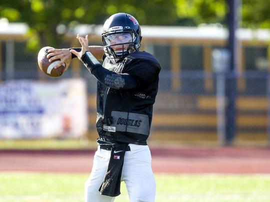 Middletown North quarterback Donald Glenn throws a
