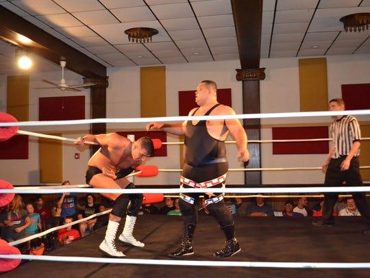 Tim Horner Jr. battles with David Tower during a Live Pro Wrestling event at the Strand Arena.