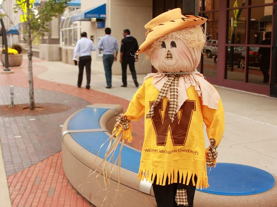 Scarecrows go up in downtown Battle Creek Wednesday afternoon.