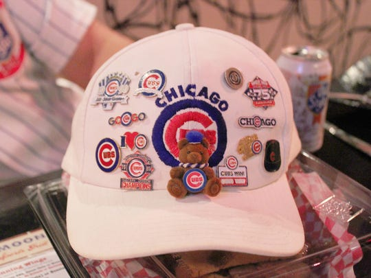 During Game 1 of the World Series, Cubs fans display their Chicago memorabilia at Half Moon Windy City Sports Grill in Phoenix.