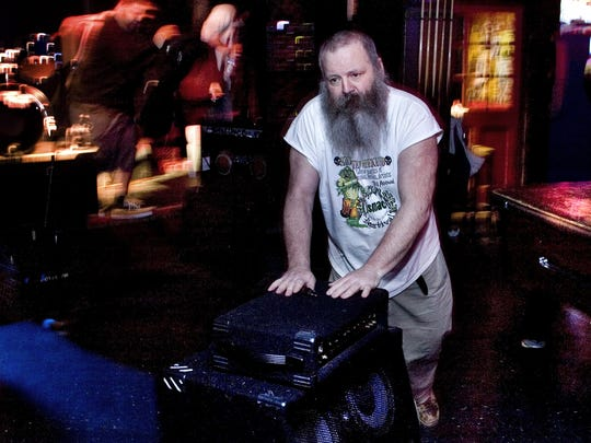 Jack Monaghan, the former manager of The Brighton Bar in Long Branch, helps the bands with their equipment in between sets in 2008.