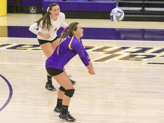 Senior libero Nicki Tetherow sets the ball for CLU,