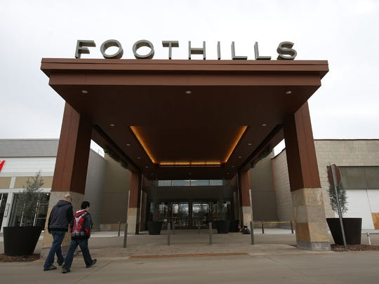 Shoppers walk into the new Foothills Mall in this file photo.