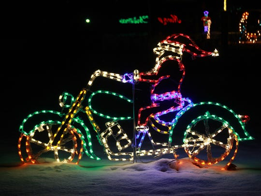 Santa on a motorcycle is part of the display at the Merry Mile at Calhoun County Fairgrounds in Marshall.