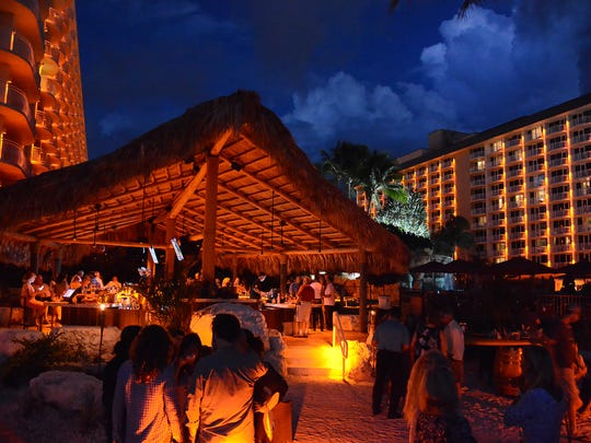 Guests mingle and watch the sunset at Kane's opening party. Kane Tiki Bar has opened at the Marco Island Marriott, offering a tropical theme, a selection of 40 rums, and a mashup of Polynesian and Indonesian-flavored small bites directly on the beach with an unsurpassed sunset view.
