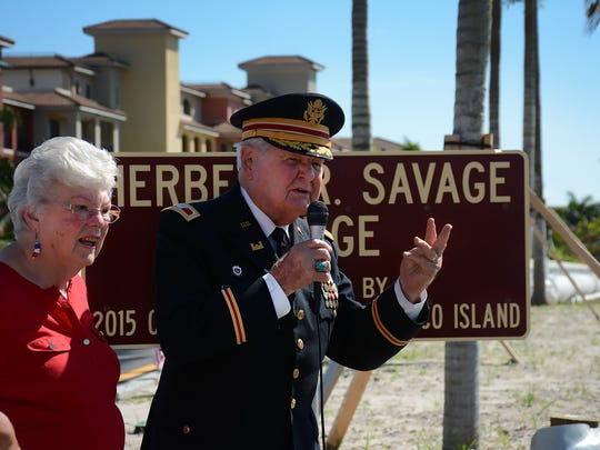 "Emily and Herb Savage lead the crowd in ""God Bless America"" as the Smokehouse Bay Bridge officially became the Herbert R. Savage Bridge in a ceremony in 2016."
