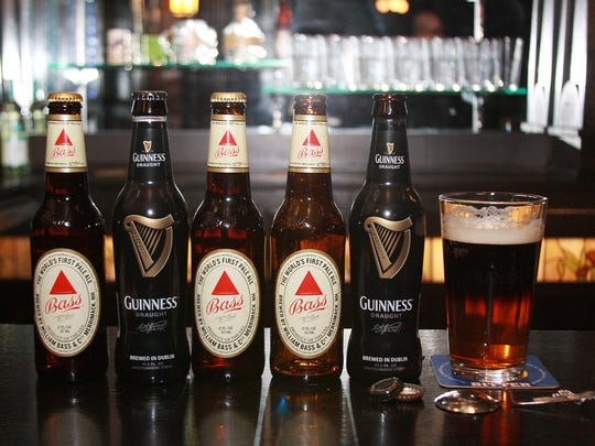 A black and tan beer cocktail can be created by combining Bass and Guinness when poured a specific way.