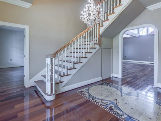 The grand entrance includes designer lighting and a