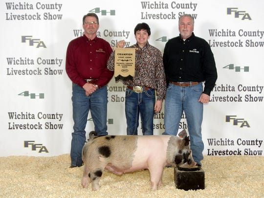 Wichita County Junior Livestock Show. The Grand Champion Market Swine was shown by Banner Young, Burkburnett FFA. The buyer was Charles Fancher of The Ford House, Banner Young, and Jeff Taylor of the Ford House. Photos courtesy of Dwayne Peirce.