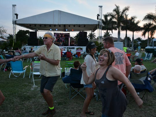 Jo-Ann Christina of Naples dances to Trezz Hombres. The Marco Island Music and Seafood Festival brought plenty of both to the the island's Veterans' Community Park on Friday, Saturday and Sunday. Lance Shearer/Special to the Daily News
