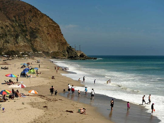 Beach-goers enjoy a sunny day at Sycamore Cove Beach in Malibu.