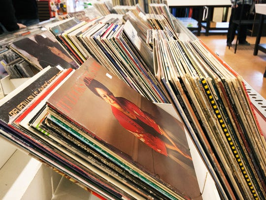 Customers can shop for vinyl records at Green Light
