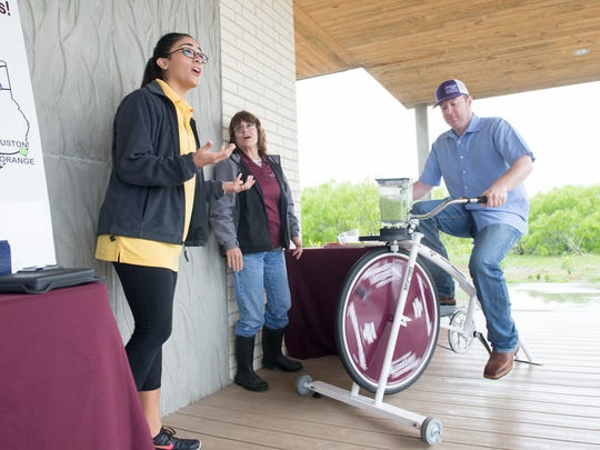Stephanie Bowman (from left), Sabie Morlan and Jason Ott demonstrate easy and healthy juice recipes with a blender  Saturday March 11, 2017 during the Walk Across Texas kickoff at the Oso Bay Wetlands Preserve.