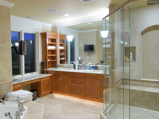 The only thing better than a TV and a bathroom? A TV in a bathroom.