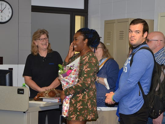 Rashida Anderson-Abdullah reacts to a surprise announcement that she had won the Jack Kent Cooke Foundation Undergraduate Transfer Scholarship. The announcement was made during her macroeconomics class on Thursday, April 13, 2017 at the Ankeny DMACC campus.