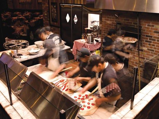 Grimaldi's Pizzeria chefs preparing and cooking signature