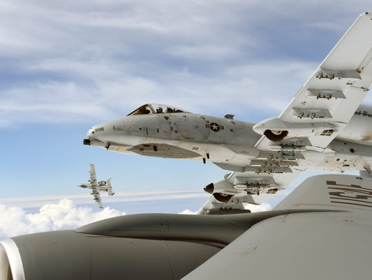 Two A-10 Thunderbolt II aircraft of the 107th Fighter