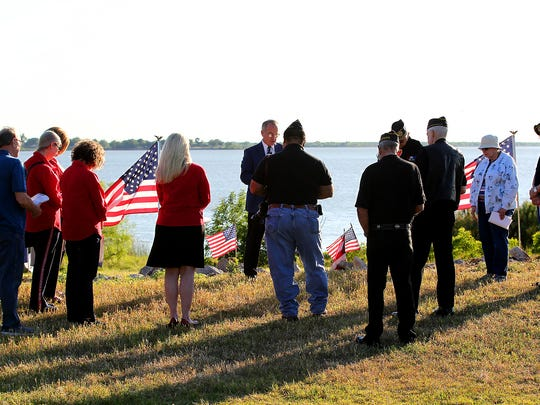 In this file photo, Steve Garner, then-chairman of the Lake Wichita Revitalization Committee, leads the inaugural prayer service on National Prayer Day with members of the Disabled American Veterans and the Daughters of the American Revolution at the future site of the Veteran Memorial Plaza. The plaza will include a bronze statue sponsored by the DAR honoring the Vietnam Veterans.