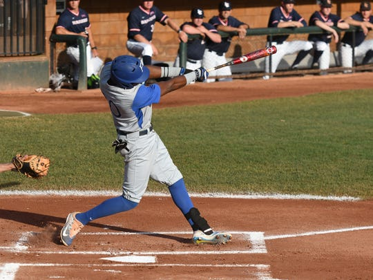 Faulkner's John Price hits a two-run homer in the first inning of the title game against Lewis-Clark State on Friday.