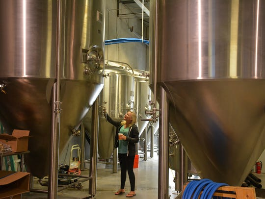"""Director of Fun"" Kaitlin Griffin inspects the 1,860-gallon"