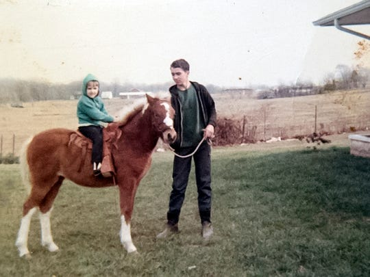 Eldest son Jim Zahm with his first pony June. Mounted on June is youngest sister Jane.