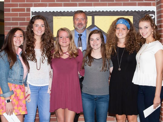 PHOTO: Jeff Shank, back row and center, recently presented health-career scholarships from the Greencastle-Antrim Endowment to, left to right, Racheal Marconi, Laurel Merriman, Brianna Roland, Morgan Clopper, Jean Hart and Corrine Statler. Missing from the photo is Alexis Sibbio.