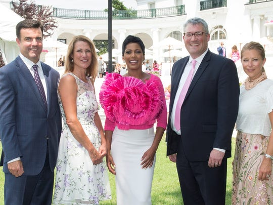 Tamron Hall, center, keynote speaker for the 22nd annual Power of Pink luncheon to benefit Monmouth Medical Center's Leon Hess Cancer Center, is pictured with, from left, Monmouth Medical Center President and CEO Bill Arnold, Kellie Geary Enstrom, president of The Women's Council for the Leon Hess Cancer Center, physician honoree Seth Cohen,  and Tara Kelly, vice president for development at Monmouth Medical Center.